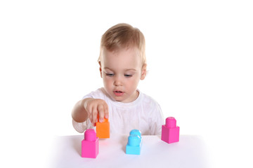 baby with toy blocks