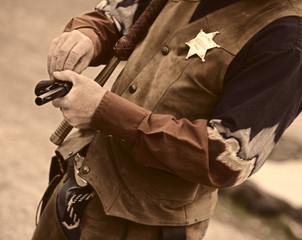old west - sherrif loads his gun