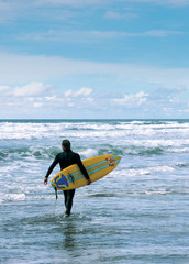 a surfer in cornwall