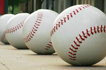 row of baseballs