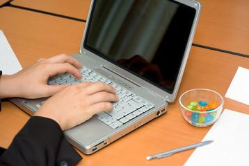 businessman's hands working on laptop