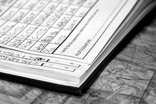 pilot logbook with flight entries