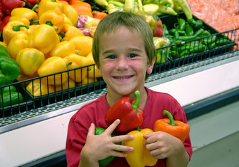 boy with arms full of peppers