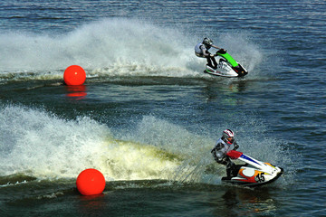 Garden Poster Water Motor sports two jetskis riding from red balls