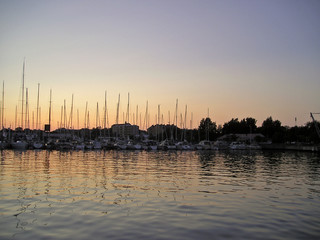 sun setting at a marina