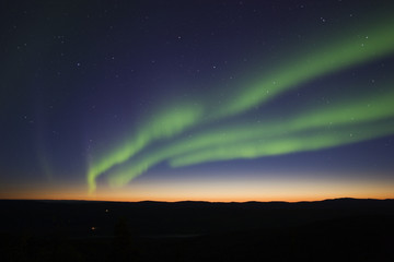 3 aurora strips over twilight