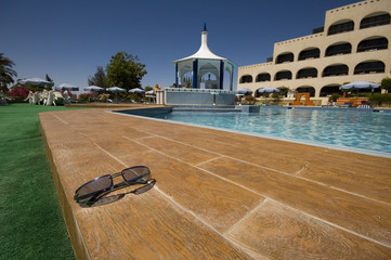 black sunglasses near pool