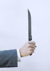 main d hommes d affaireset couteau