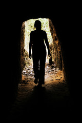 woman inside cave