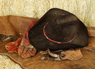 hat, gloves and spurs