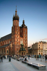 people relaxing on square in krakow
