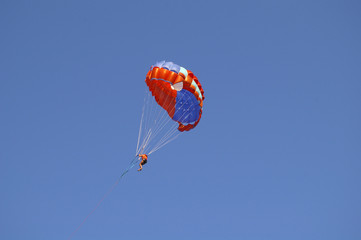 paraglider on the blue sky.