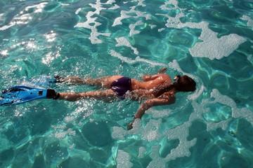 sexy woman swimming in lagoon