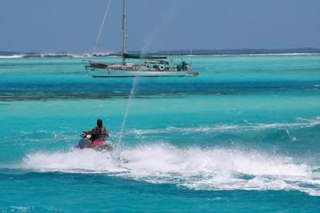 jetski passing a sailboat