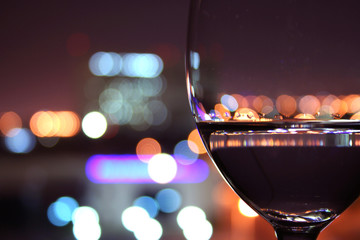 wine glass with blurred lights