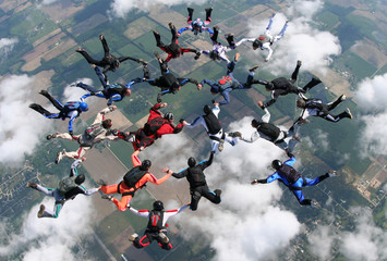 skydivers make a formation