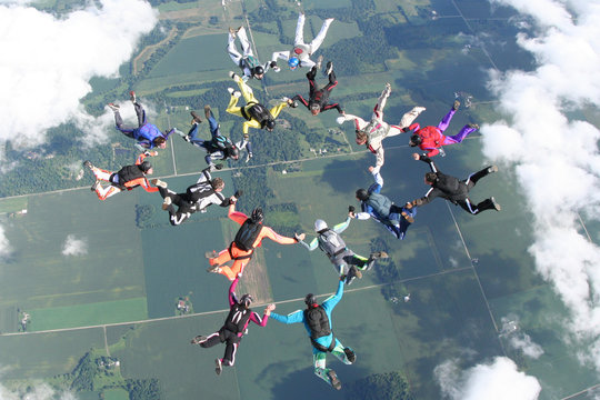 16 skydivers in freefall together