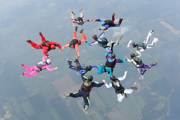 12 skydivers complete a formation in freefall