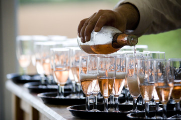 waiter pouring champagne in glasses