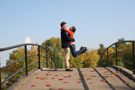 couple on autumn bridge