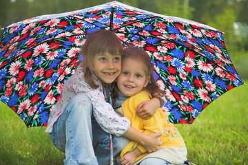 two girl play umbrella