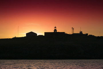 silhouette of an island and lighthouse