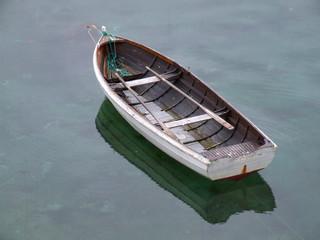 old fishing boat on still water