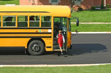 boy getting off bus