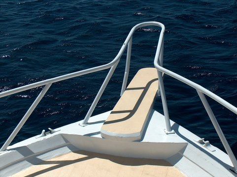 a bow of a boat against water surface
