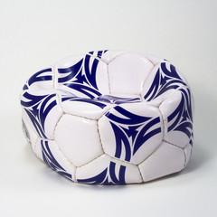 flattened white and blue soccer ball