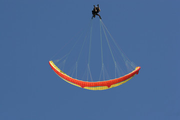 paraglider performing perfect looping manoeuvre