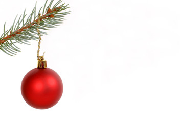round red christmas ornament hanging from evergreen branch
