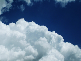 large cloud against blue sky