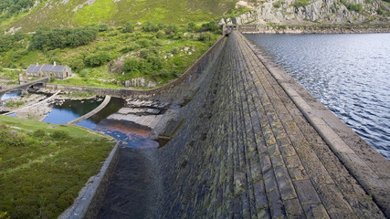 reservoir and dam with high water level overlookin