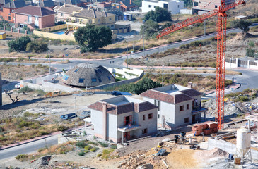 aerial view of construction site, villas and cranes