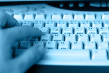 male hand on computer keyboard