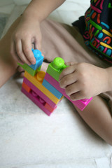 kid playing blocks