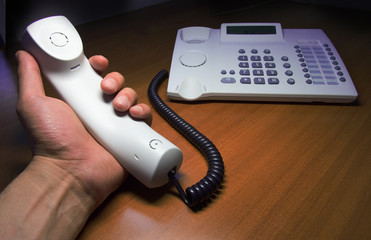 telephone headset in hands