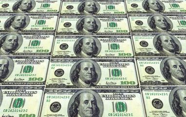 wall of one hundred dollar bills