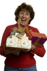 happy woman with gifts stack