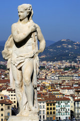 statue above florence