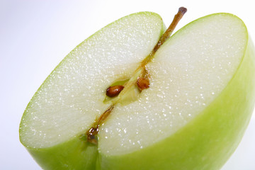 fruit,  a green apple, with a tail
