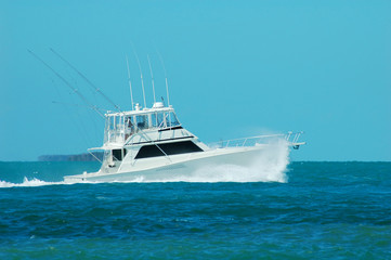 a yacht fishing boat speeds up