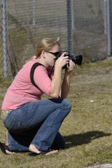 crouching photographer