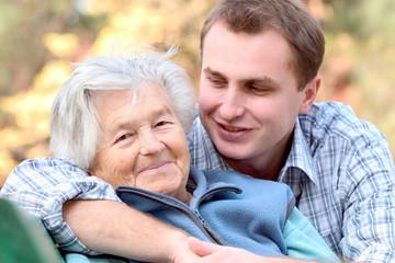 elderly person with grandson