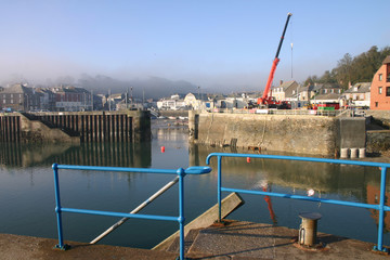 early morning mist clearing from padstow harbour