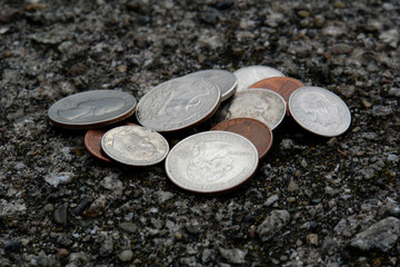 stack of american coins on the ground