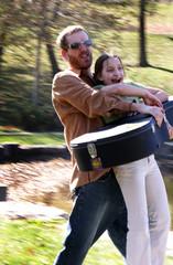 man carrying girl and guitar