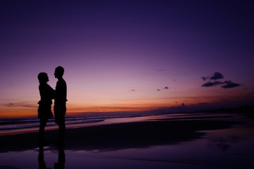 couple standing on the beach