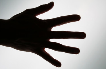 conceptual photo of a hand ready to take or achiev